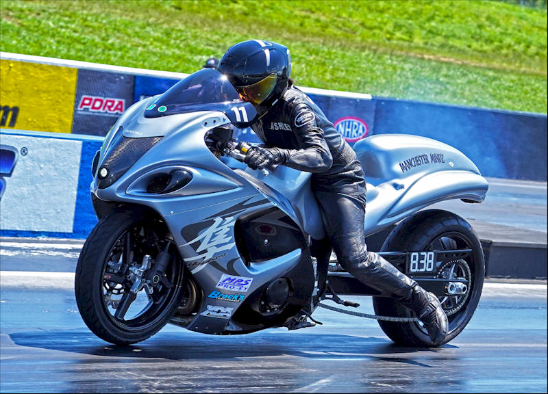 Real Street drag racer Ashley Cotnoir on her motorcycle at the XDA Superbike Showdown ready to take off down the track